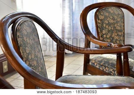 A sight of a chair near a window on a sunny day