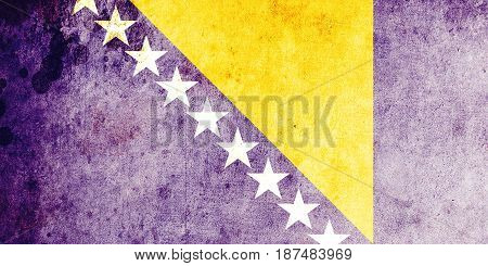 Bosnia and Herzegovina flag grunge background. Background for design in country flag