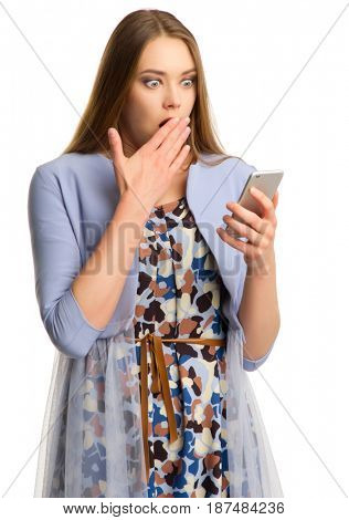 Young woman with smartphone isolated on white