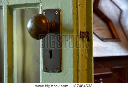 Sight of the door of the room with knob and keyhole