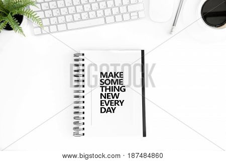 Top View Of Make Something New Every Day Motivational Quote In Diary, Computer Mouse And Keyboard Is