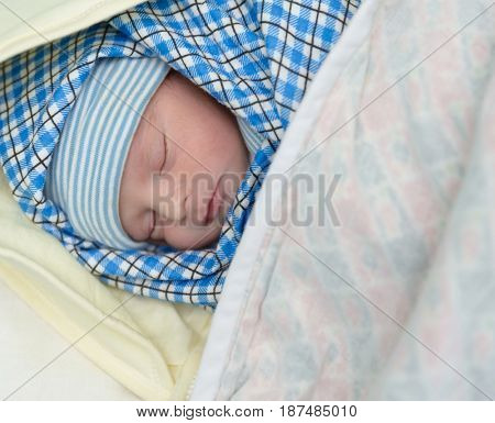 Mixed race south asian and caucasian newborn baby sleeping