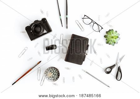 Top View Of Wallet, Camera And Various Office Supplies And Plant Isolated On White