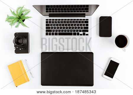 Flat Lay With Various Wireless Devices And Coffee Cup On Modern Workplace