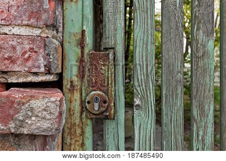 Old Wooden Gate With A Lock