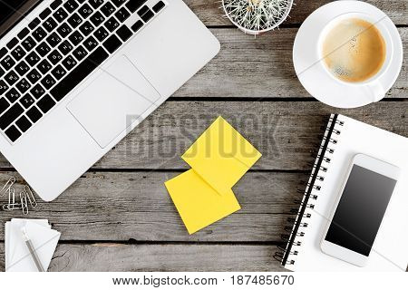 Top View Of Wireless Digital Devices And Blank Cards On Workplace