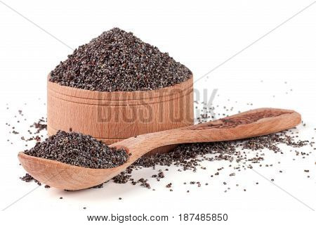 poppy seeds in a wooden bowl and spoon isolated on white background.