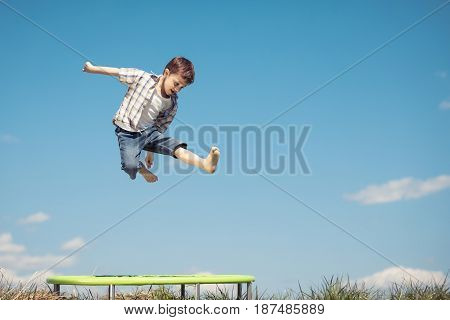 Little Boy Playing On The Field At The Day Time.