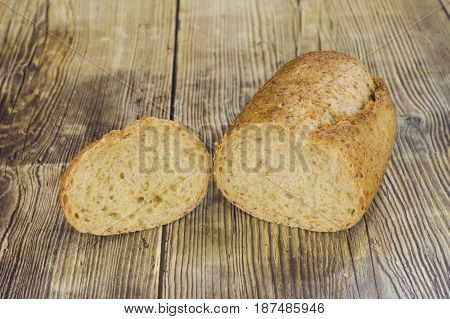 A piece of soy bread on a rustic wood