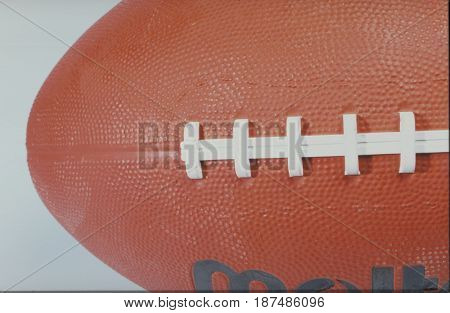 Close up of an oval ball used in both rugby and American football.