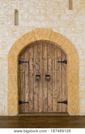 Wooden door in a stone castle. The scenery on the stage of the theatre