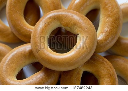 Heap of baked dry bagels close-up, top view