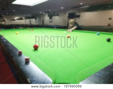 Blurred snooker players put cue ball for shooting