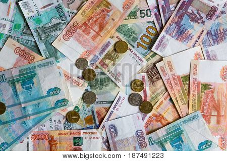 Business. Many monetary denominations of different denominations and coins. Rubles and dollars.