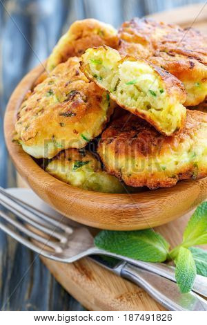 Tasty Fritters Of Zucchini In A Wooden Bowl.