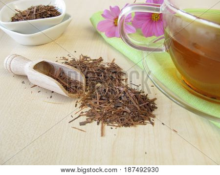 Glass cup of Lapacho tea and tea bark