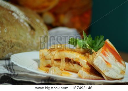 Pickled camembert/ The cheese pickled in  vegetable or olive oil with onion, garlic and spice.
