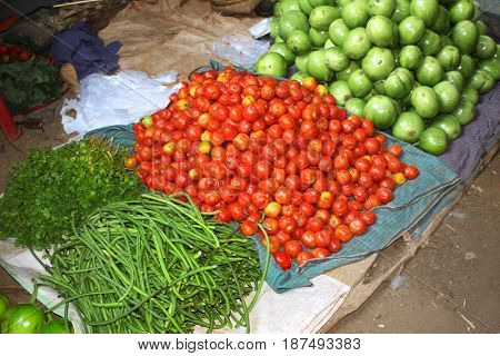Fresh vegetables - tomato, onion, green beans, eggplants on traditional morning market, Myanmar (Burma)