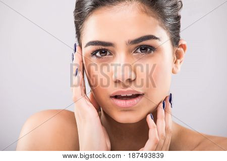 Beauty Woman Face Portrait Close Up. Beautiful Model Girl With Perfect Fresh Clean Skin On Grey