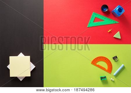 school supplies at abstract colorful background texture