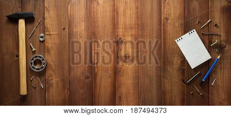 construction tools on wooden plank background