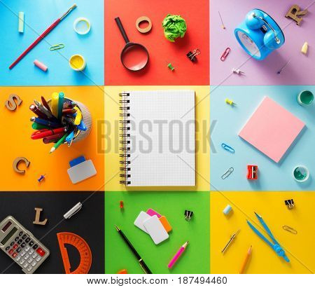 school supplies at abstract colorful paper background texture