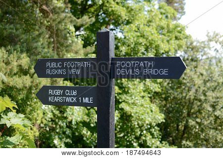 A finger post sign at Kirkby Lonsdale showing directions