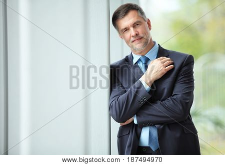 cheerful businessman with arms folded looking at the camera