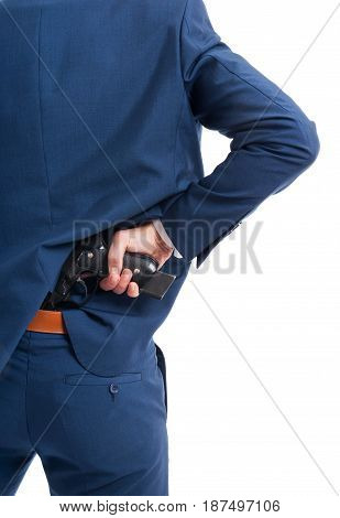 Man Taking A Gun From His Back