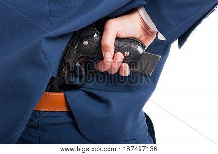 Closeup Of Gun In Salesman Suit Pants
