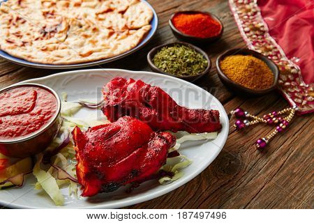 Chicken Tandoori indian recipe with spices on wood