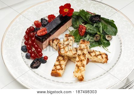 Liver foie gras with croutons and berries with molecular gastronomy poster