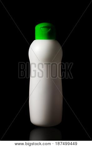 Bottle dish washing soap plastic isolated on black background