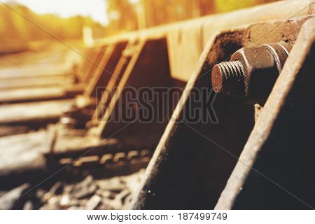 Closeup of vintage railroad truck. Sunlight filtered picture.