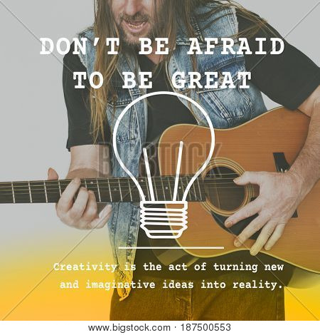 Dont Afraid To Be Great Word on Man Playing Guitar Background