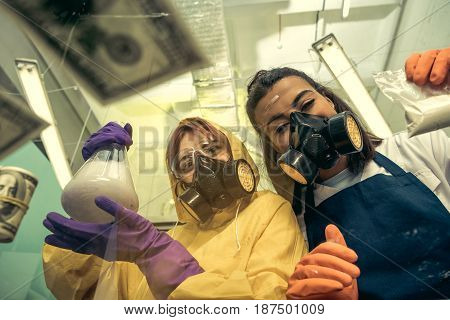 Two Young Women Chemists Working At Scientific Laboratory With Drugs, Researchers In Lab