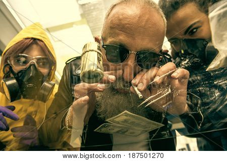 Grey Hair Man With Beard Taking Drugs With Women In Personal Protective Equipment, Drugs Concept