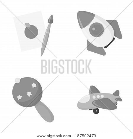 A sheet of paper with an apple pattern, a paint brush, a flying rocket with a porthole, a rattle for a child, an airplane with a chassis and a porthole. Toys set collection icons in monochrome style vector symbol stock illustration .