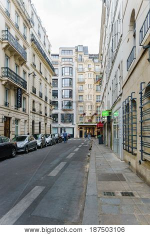 Paris France - May 1 2017: Rue Geoffroy - Marie road in evening the small alley in central Paris on May 1 2017 in Paris France.