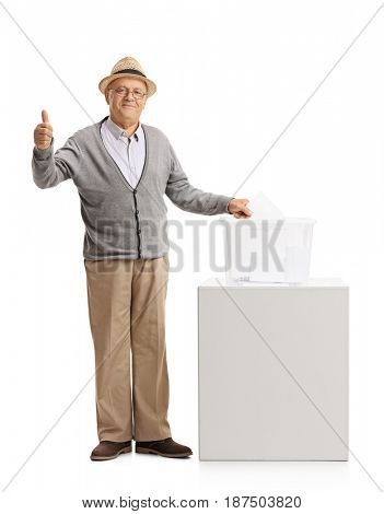 Full length portrait of a mature man voting and making a thumb up gesture isolated on white background
