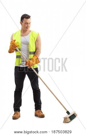 Full length portrait of a waste collector sweeping with a broom isolated on white background