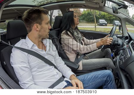 couple traveling in a car