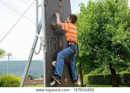 Effort Of A Boy In Climbing A Wall