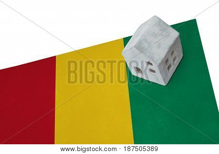 Small House On A Flag - Guinea