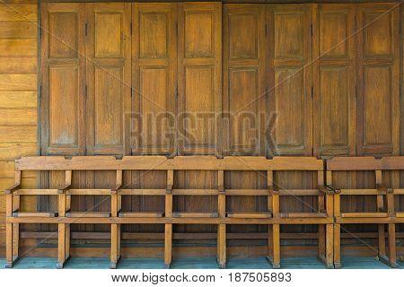 Wooden Bench And The Wooden Door Swing. Vintage Tone