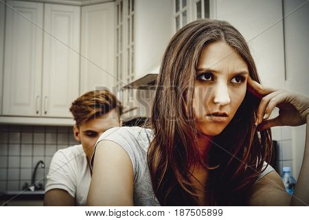 Couple having an argument in the kitchen.