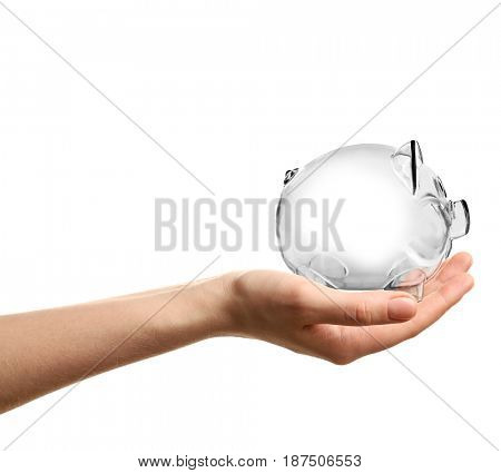 Woman holding piggy bank on white background