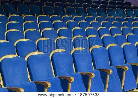 Empty auditorium of the theater, blue velvet chairs
