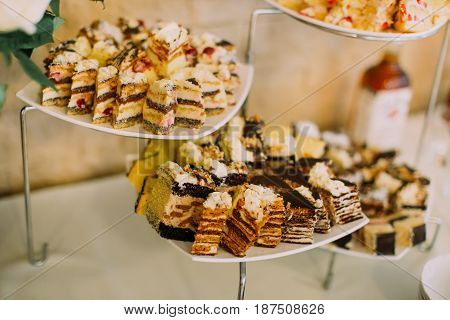 The composition of the wedding cakes with chocolade placed on the desset stand