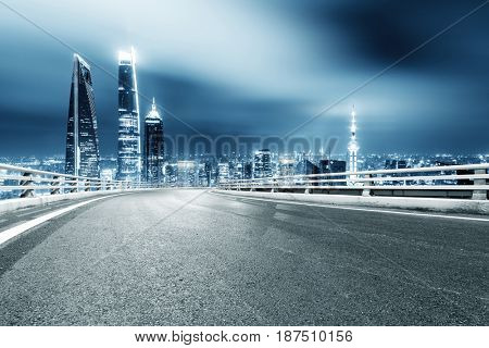 night scene of empty road in midtown of shanghai